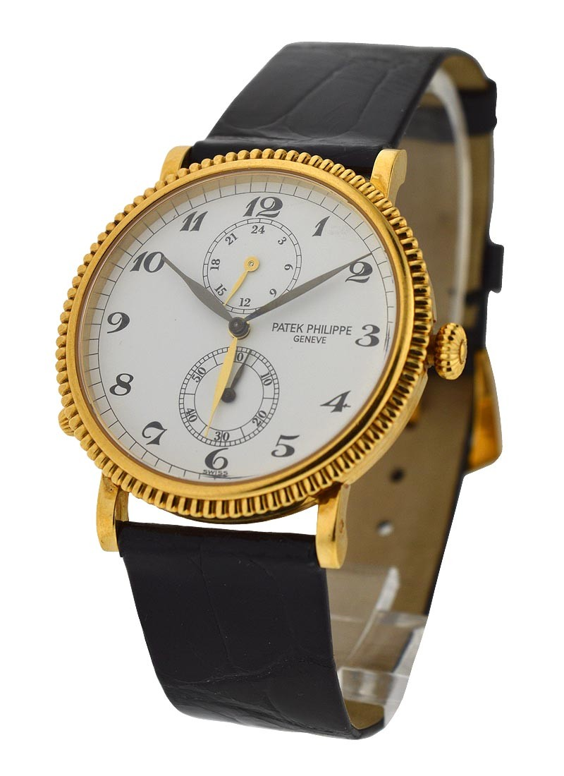 Patek Philippe 5034J Travel Time in Yellow Gold with Hobnail Bezel - Discontinued