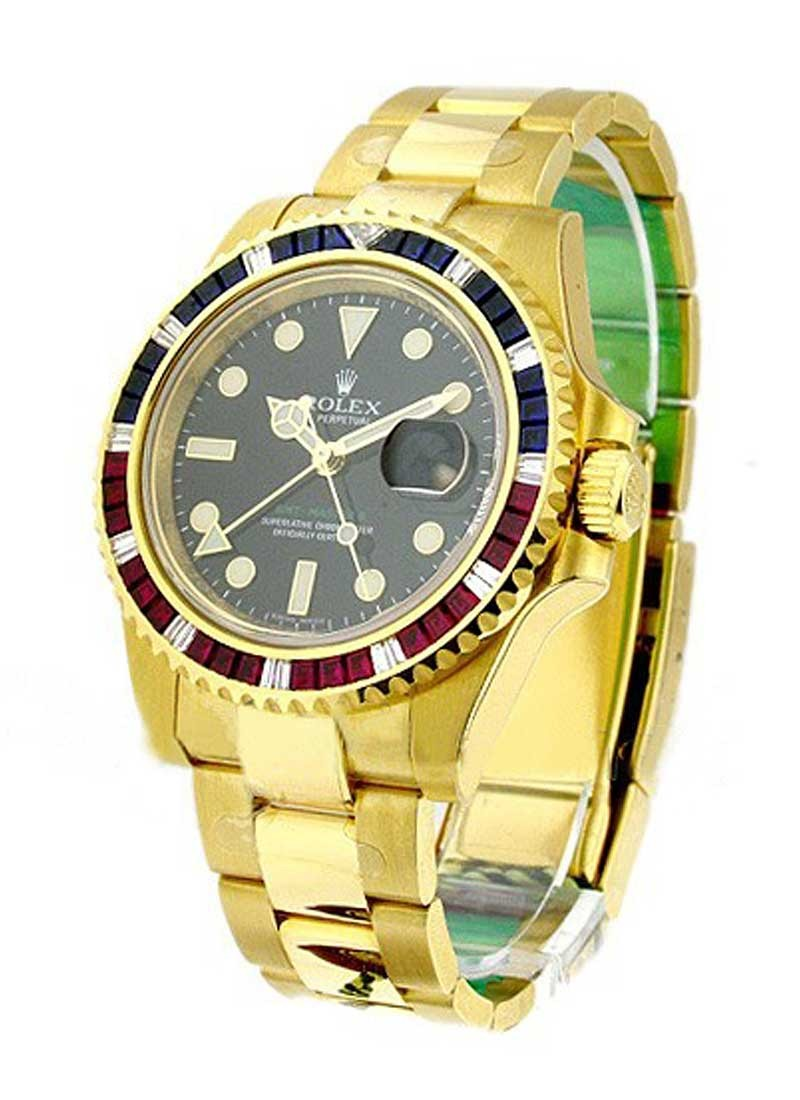 Rolex Unworn GMT Master II in Yellow Gold with Ruby and Sapphire Diamond Bezel