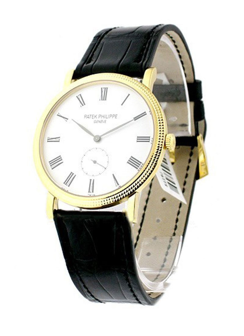 Patek Philippe 5119J 36mm Calatrava in Yellow Gold with Hobnail Case