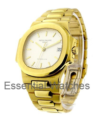 Patek Philippe Nautilus Men's Size   Yellow Gold with Off White Dial