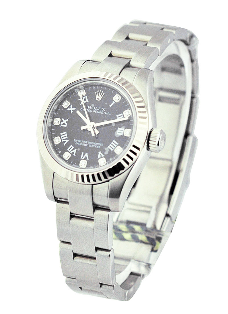 Rolex Unworn Oyster Perpetual No Date in Steel with Fluted Bezel