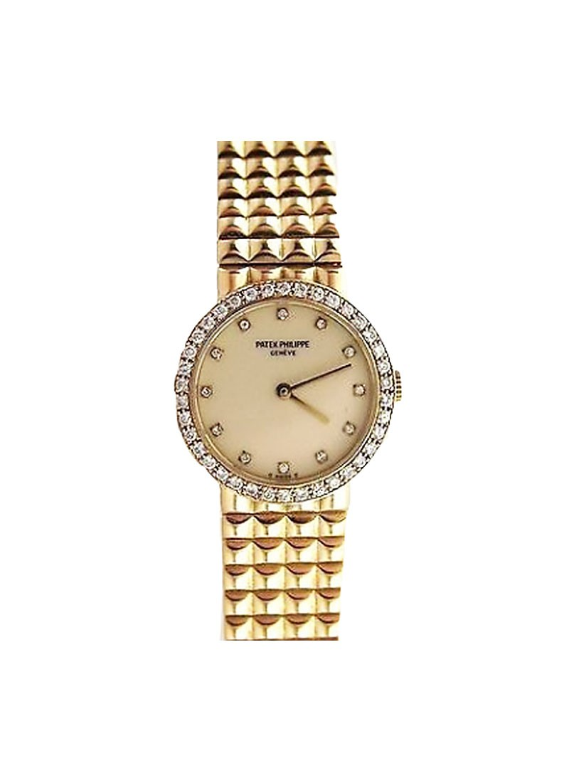 Patek Philippe Ladies in Yellow Gold with Diamond and Sapphire Bezel